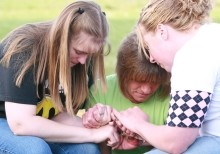Teens praying together