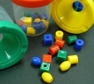 Preschool beads and their containers for sorting and making patterns.