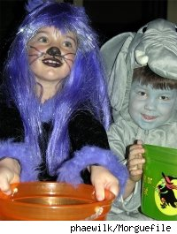 Two kids in costume, trick-or-treating