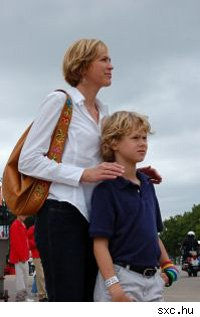 mother standing with son