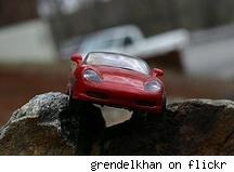 toy car perched on rocks