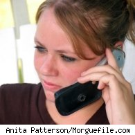 A young woman talking on a cell phone