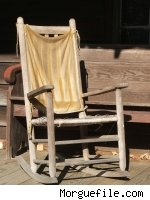 An old rocking chair on a porch