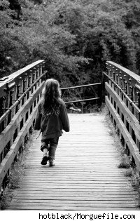 A girl crossing a bridge by herself