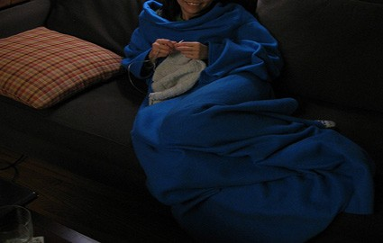 woman knitting in snuggie