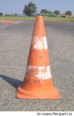 An orange and white striped traffic cone