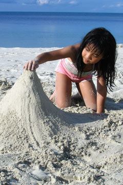 girl digging in sand