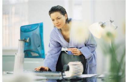 Checking email in your bathrobe is OK, just put on some clothes before you drop off the kids. Credit: Getty Images