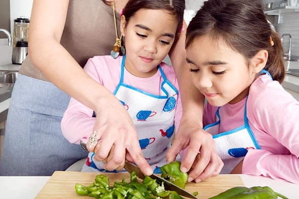 Children cooking healthy food