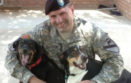 Soldier with rescued dogs picture