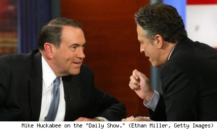 Mike Huckabee and Jon Stewart