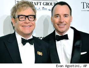 http://www.blogcdn.com/www.popeater.com/media/2010/12/elton-john-david-furnish-294ss1-122810.jpg