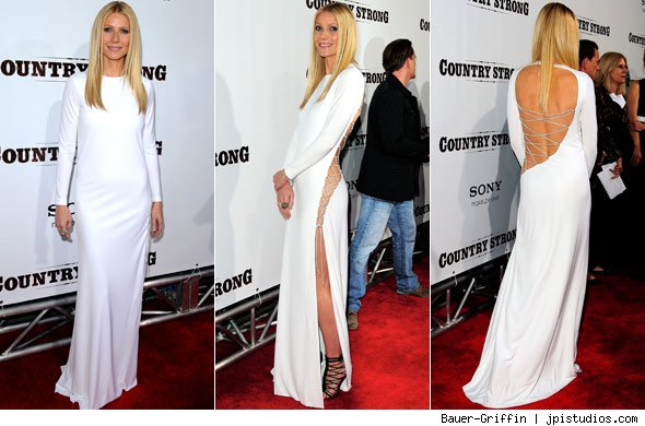 Gwyneth paltrow wears daring slit dress at premiere popeater com