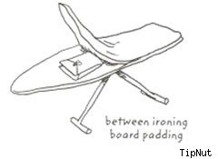 use an ironing board to hide items