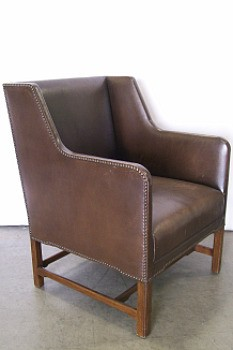 A leather wing chair or this month's rent? You decide.