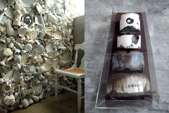 Salvaged items glued to a wall. Metal containers displayed as art.