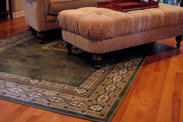 Cleaning area rugs on hardwood floors for Rugs for laminate floors