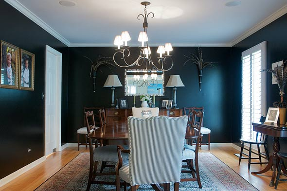 black wall black formal dining room