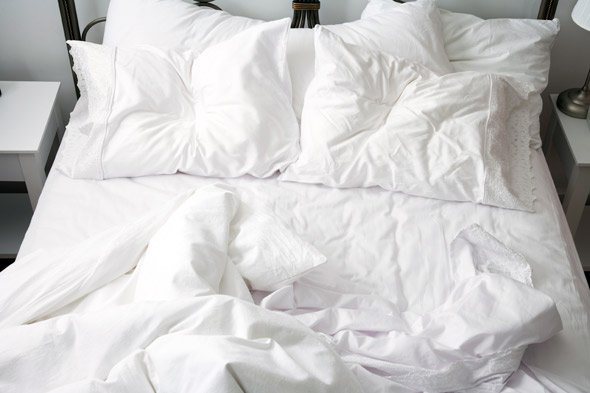 cleaning and changing bedsheets