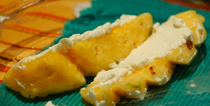 Pineapple spears spread with ricotta cheese