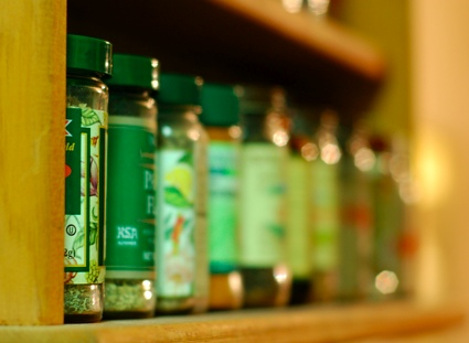 a row of spice jars on a shelf