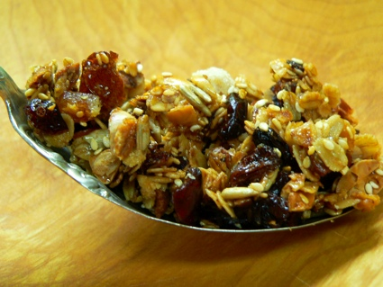 an old serving spoon, filled with homemade granola