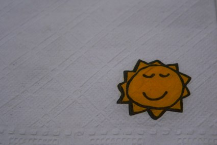 an image of a sun printed on a napkin
