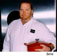 an image of Mario Batali holding a pot from his line