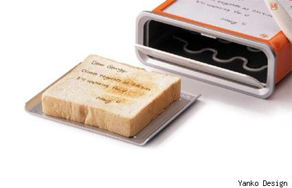 toaster of the future writes notes on toast