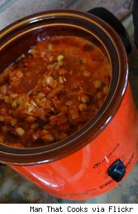a filled orange slow cooker