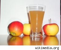 Apple juice and some apples.