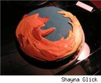 Cake decorated with Mozilla Firefox logo.