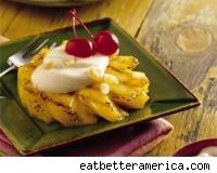 Grilled pineapple with ginger cream and cherries.