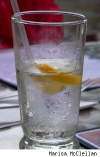 water glass with straw and lemon