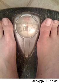 View of a persons feet on a scale.