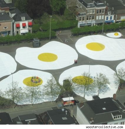 an aerial view of an art project that looks like giant fried eggs.