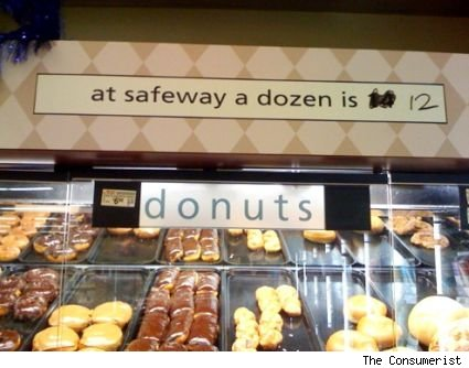 safeway sign in which the number of baked goods in a dozen has been reduced