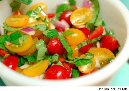 bowl of tomato, onion and basil salad
