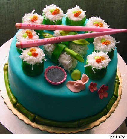 a cake decorated with faux vegetarian sushi
