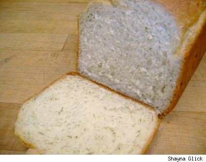 Up close image of a loaf of dill bread with the end cut off.