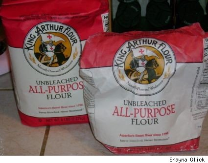 Two bags of King Arthur all purpose flour, one is open.