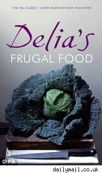 THe covr of delia smith's new re-released cookbook, frugal food, featuring a head of cabbage.
