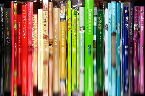 row of color coded cookbooks