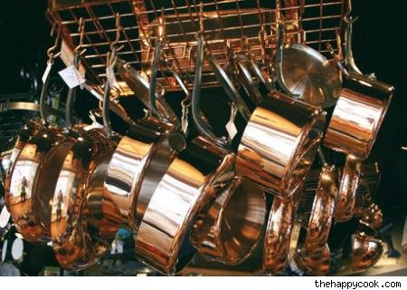 a pot rack full of pots