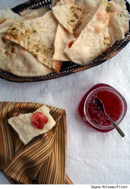 lavash and jelly on a white clothed table