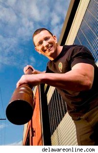 robert irvine wielding a pepper mill