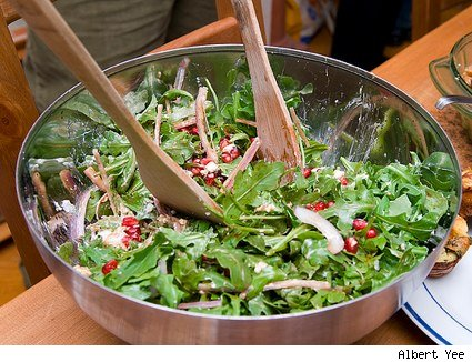 bowl of arugula, goat cheese and pomegranate salad