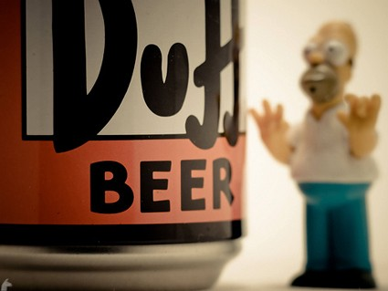 Homer Simpson stares at a can of Duff Beer.
