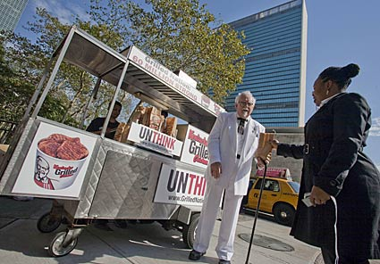 kentucky fried chicken's colonel sanders gives away free grilled chicken outside the united nations