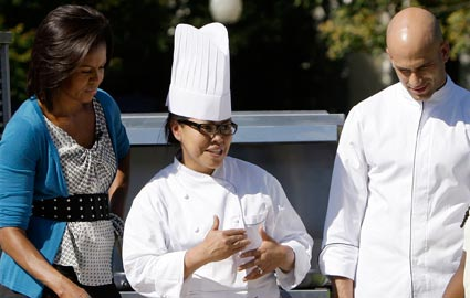 michelle obama with cristeta comerford and sam kass
